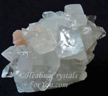 Clear Apophyllite Cluster includes apricot Stilbite